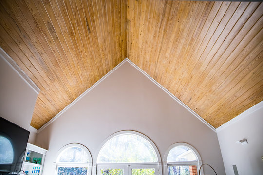 pine wood plank vaulted ceiling of a residential home house