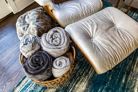 Home Organization and storage of living room den soft blankets for the winter for an organized home