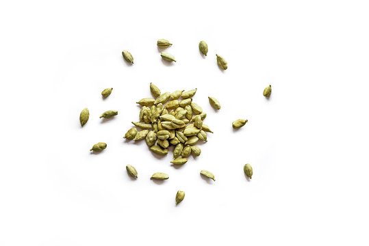 Top view of a pile of organic dry cardamom seeds isolated on a white background