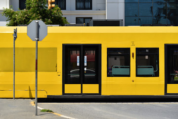 yellow wagons of ground metro in downtown