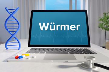 Würmer – Medizin/Gesundheit. Computer im Büro mit Begriff auf dem Bildschirm. Arzt/Gesundheitswesen