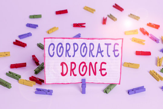 Conceptual hand writing showing Corporate Drone. Concept meaning unmanned aerial vehicles used to monitor business vicinity Colored clothespin papers empty reminder white floor office