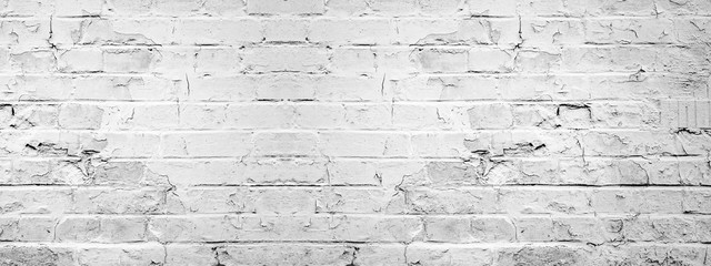 Photo sur Aluminium Mur White gray light damaged rustic brick wall texture banner panorama