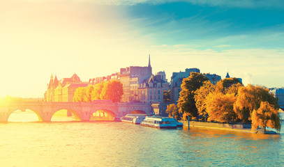 Autumn view of the Pont Sully and Square Barye on Saint Louis island from over the Seine river, Paris, France. Toned image with sunshine, Sun flare and golden seasonal Autumn leaves.