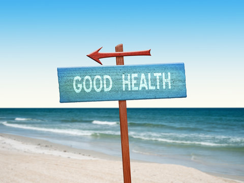 Good Health sign at beach for lifestyle wellness concept.
