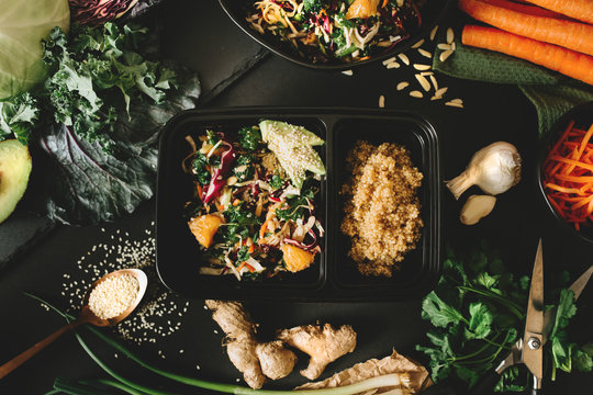 Meal Prep Container with fresh Salad and Quinoa