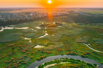 Aerial View Of Plain With Green Forest Woods And River Landscape In Sunny Spring Evening. Top View Of Beautiful European Nature From High Attitude In Summer Season. Drone View. Bird's Eye View