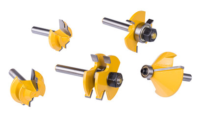 Milling cutters set. Steel cutting tools isolated on white background. Group of yellow sharp shank router bits. Equipment for edge trimming or shaping in woodworking. Joinery and furniture production.