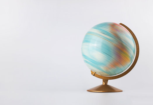 Spinning globe model in motion isolated on white background