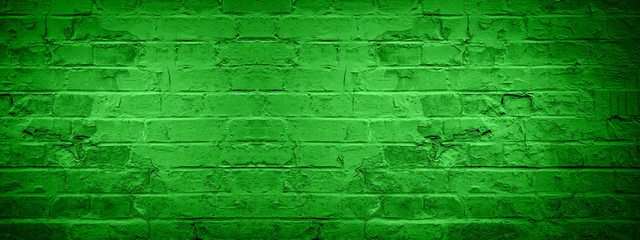 Green damaged rustic brick wall texture banner panorama, colorful trend color 2020 germany