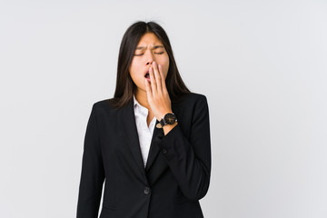 Young asian business woman yawning showing a tired gesture covering mouth with hand.