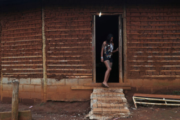 A Guarani Mbya indigenous woman leaves a temple at Aldeia Tekoa Pyau as the indigenous group protests against tree cutting and the construction of an apartment complex in Sao Paulo