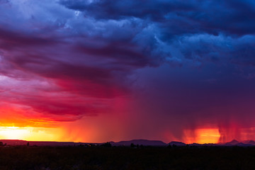 Colorful sunset sky with dramatic storm clouds