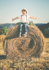 happy child playing in wheat field