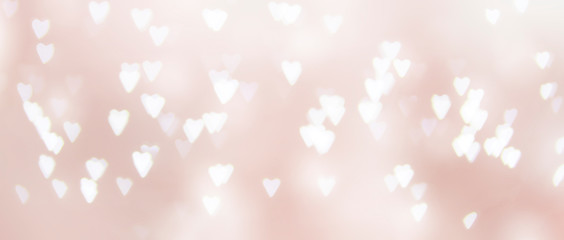pink background of unfocused hearts
