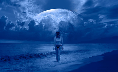 "Silhouette of a beautiful woman standing on the beach on the background full moon ""Elements of this image furnished by NASA """