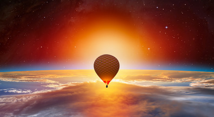 Fototapete - Hot air balloon on the foreground Planet Earth with a spectacular sunset