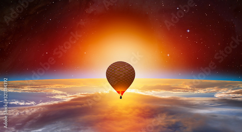 Wall mural Hot air balloon on the foreground Planet Earth with a spectacular sunset
