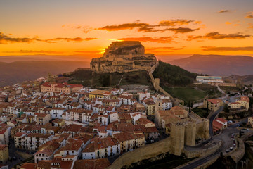Sunset over medieval Morella walled town and fortress in Spain known for honey