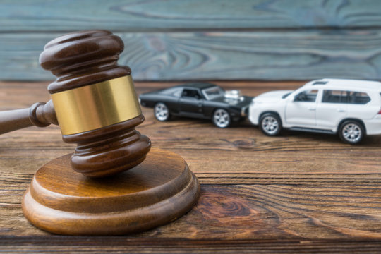 Judge gavel and two cars colliding, traffic accident, insurance, fault. Court law