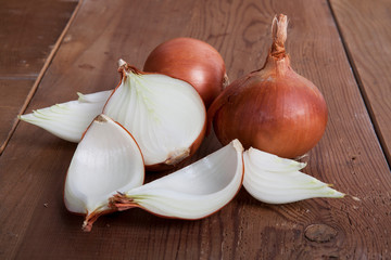 Onion on the wooden table.