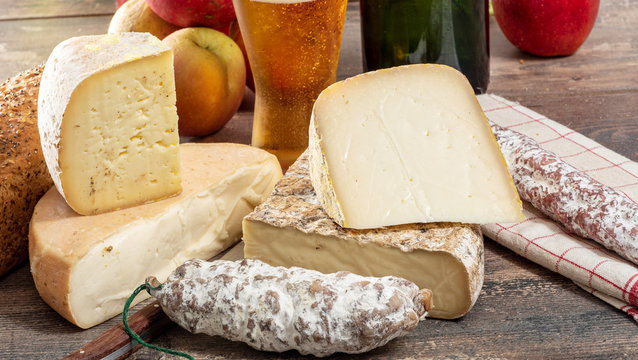 cheeses and Tomme de Savoie with beer, French cheese Savoy, french Alps France.