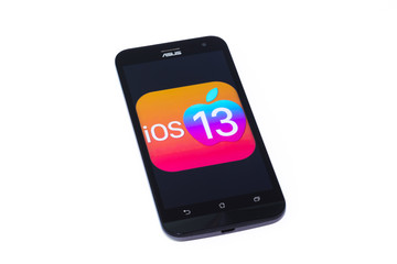 Kouvola, Finland - 23 January 2020: iOS 13 logo on the screen of smartphone Asus