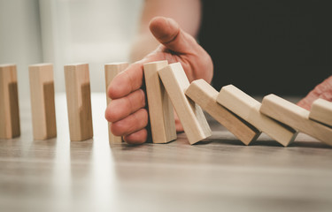 Concept of business control by stopping domino effect