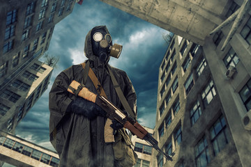 lonely post survivor in mask wanders through the ruined city.