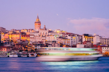 Istanbul, Turkey - Jan 15, 2020: Galata Tower with Ferry Boat in Golden Horn , Istanbul, Turkey,