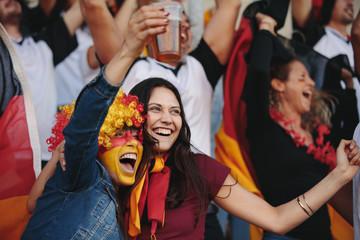 German supporters celebrating at stadium