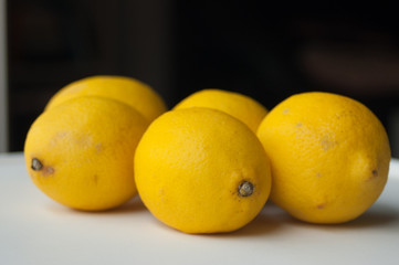 lemons on white table and black background