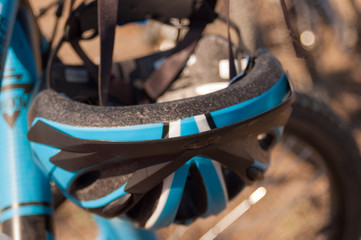 closeup of bicycle hanging helmet