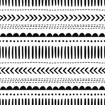 African hand drawn vector seamless pattern. Geometrical black doodle shapes on white background. Dot, zigzag, dash line decorative backdrop. Monochrome wrapping paper, wallpaper design