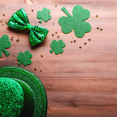 Happy Saint Patrick's Day greeting card with traditional symbols, shamrock, green attire. Green...