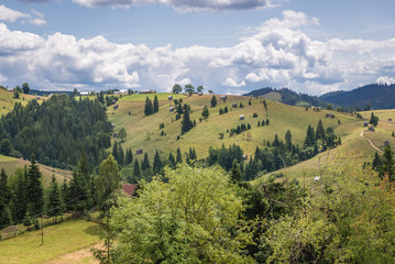 Mountain landscape seen from Ciumarna mountain pass in Obcina Mare ridge of Eastern Carpathian Mountains Romania