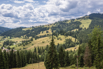 Aerial view from Ciumarna mountain pass in Obcina Mare ridge of Eastern Carpathian Mountains Romania