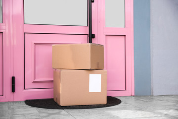 Delivered parcels on door mat near entrance