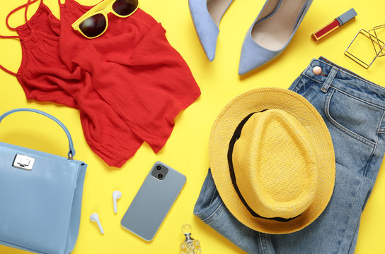Flat lay composition with smartphone and stylish clothes on yellow background