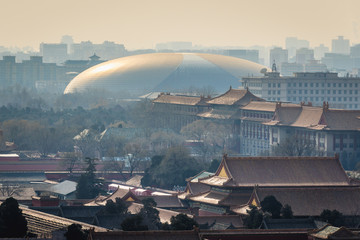 Beijing, China - February 8, 2019: National Grand Theatre building seen from a hill in Jingshan Park, former imperial park in Beijing