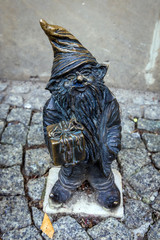 Wroclaw, Poland - December 2, 2019: Characteristic dwarf statuette in historic part of Wroclaw city