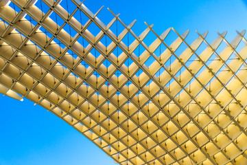 The Metropol Parasol (officially called Setas de Sevilla) is a structure in the shape of a pergola made of wood and concrete located at La Encarnacion square in the old quarter of Seville, Spain