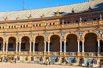 SEVILLE, SPAIN - DECEMBER 16, 2017: Tiled Provincial Alcoves along the walls of the Spain Square (Plaza de Espana) in Seville (Sevilla), Andalusia, Spain. Example of Moorish and Renaissance revival