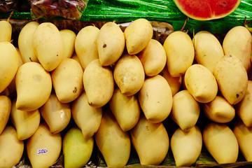 Mango and pineapple at fruit market