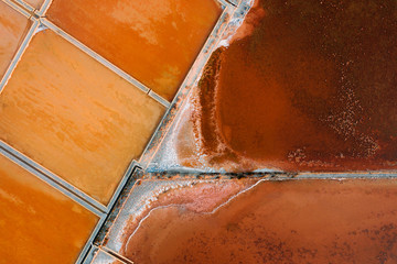 Aerial image of colorful salt mines in Sicily, Italy.
