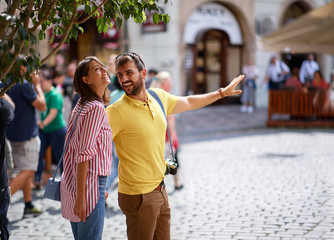 couple in love traveling,europe vacation,happy positive mood, smiling,  having fun.