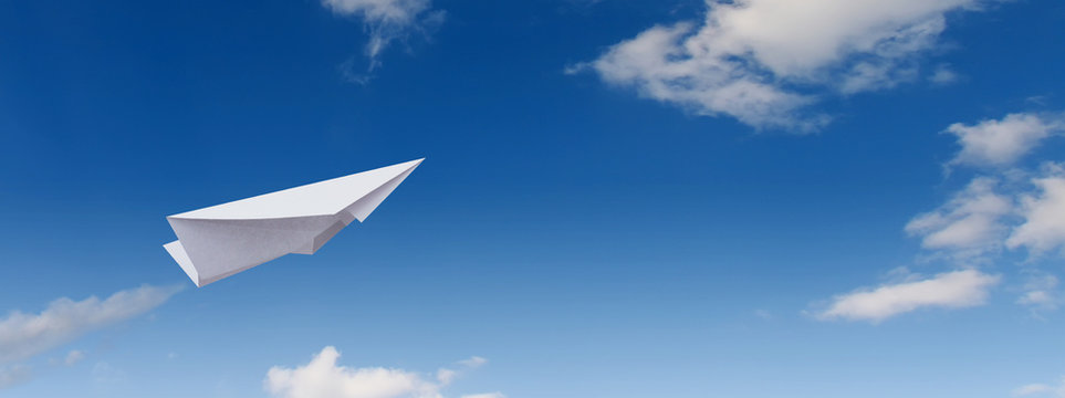 Paper plane in the blue sky.