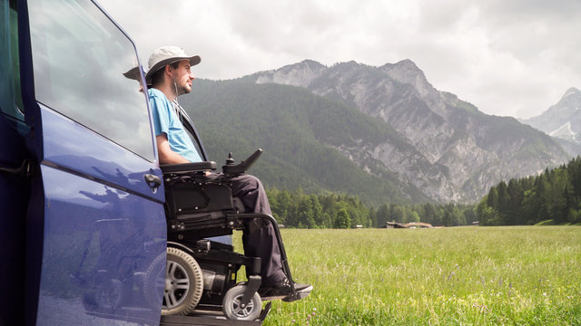 electric lift specialized vehicle for people with disabilities. Empty wheelchair on a ramp with nature and mountains in the back