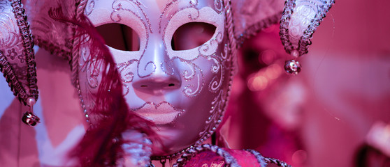 a pink background for the carnival mask