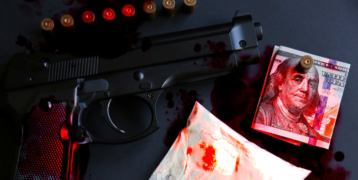 Gun with bullets lying on the table. Criminal problems. Drugs and money on black background. Illegal selling.